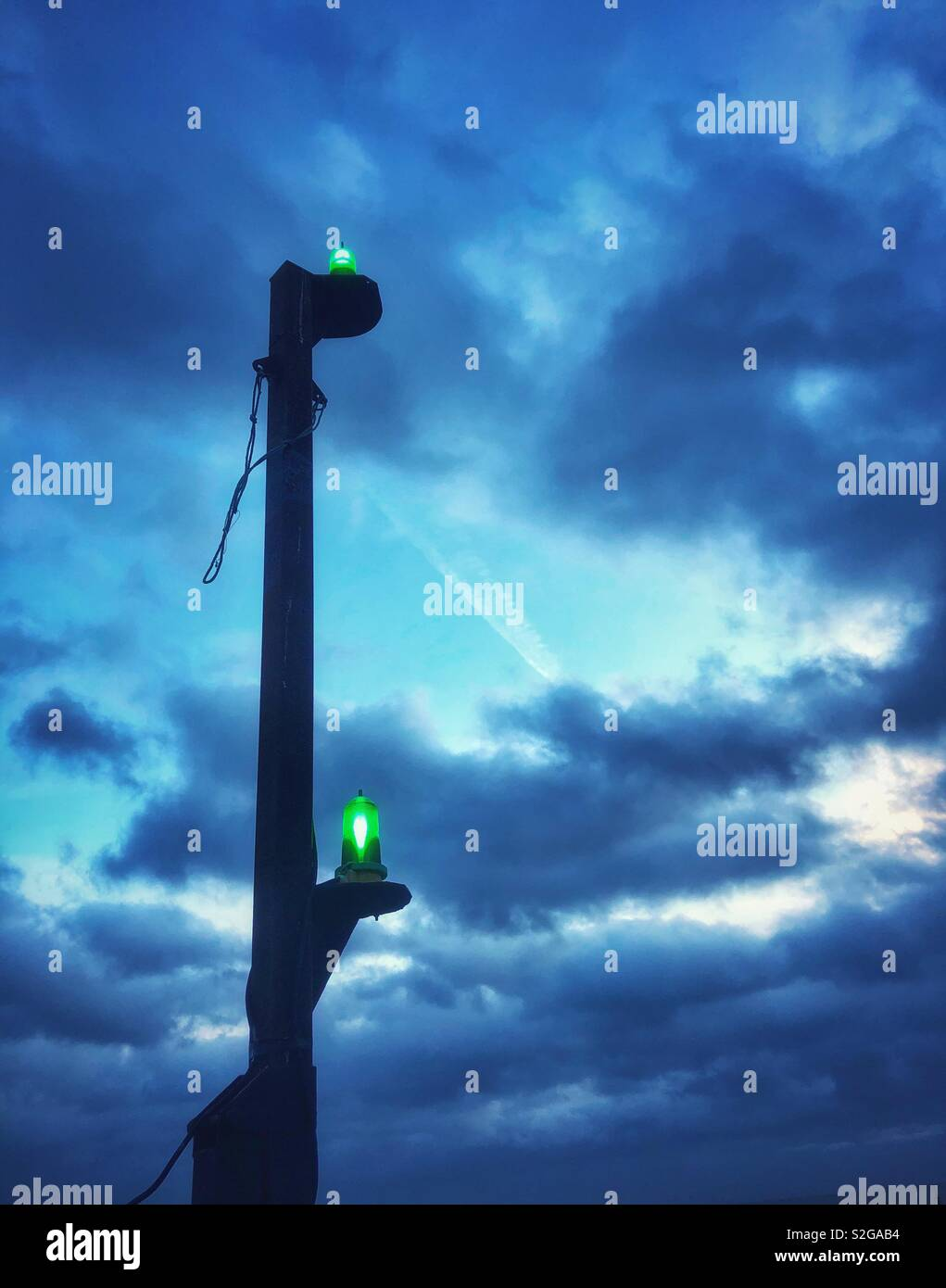 Starboard shipping lights on a South Wales pier, dusk, January. - Stock Image