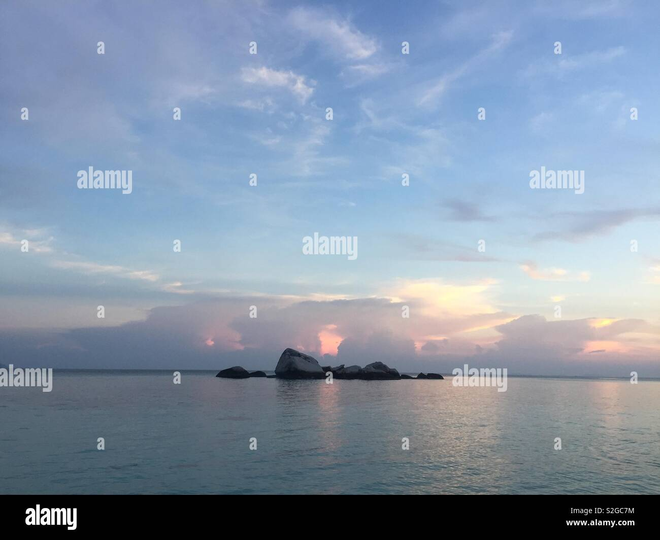Small rocky island in the South China Sea during sunset. - Stock Image