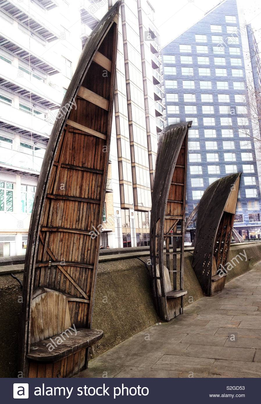 Unusual rowing boat shaped benches next to the Victorian White Hart Dock on the Albert Embankment, London Stock Photo