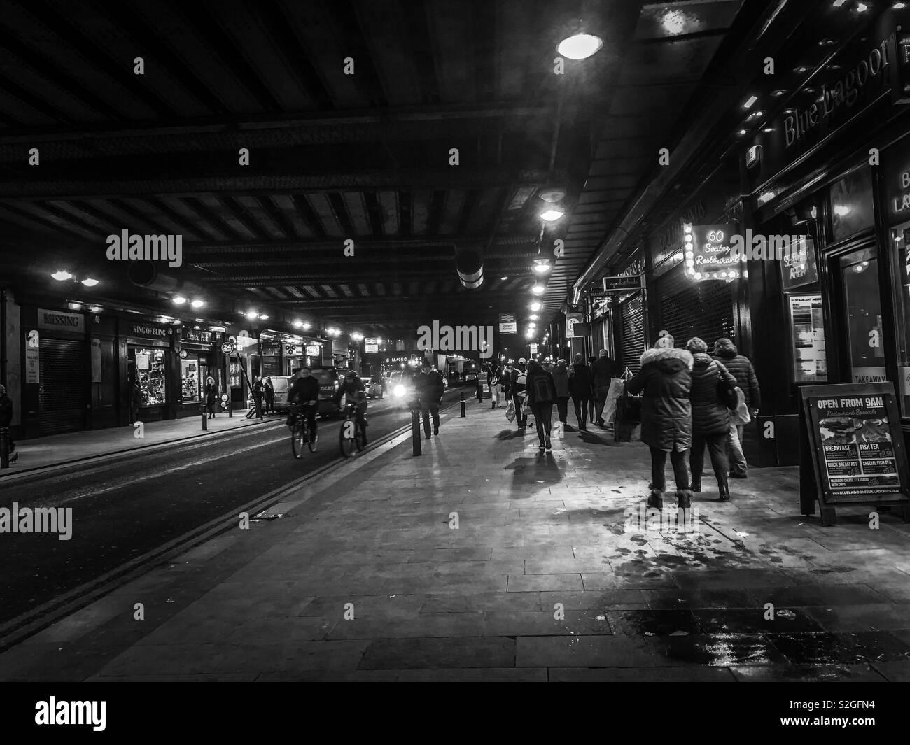 Night scene. Under Glasgow Central station railway bridge, locally known as the Hielanman's Umbrella. Scotland. UK. - Stock Image