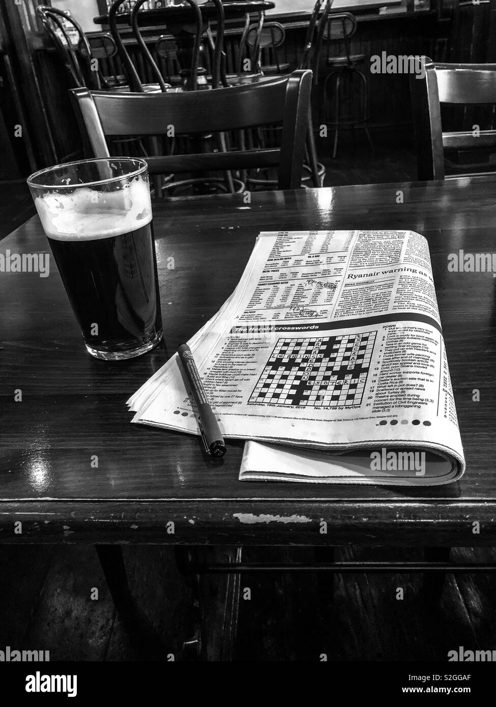A pint of beer and the crossword. Glasgow. Scotland. UK. - Stock Image