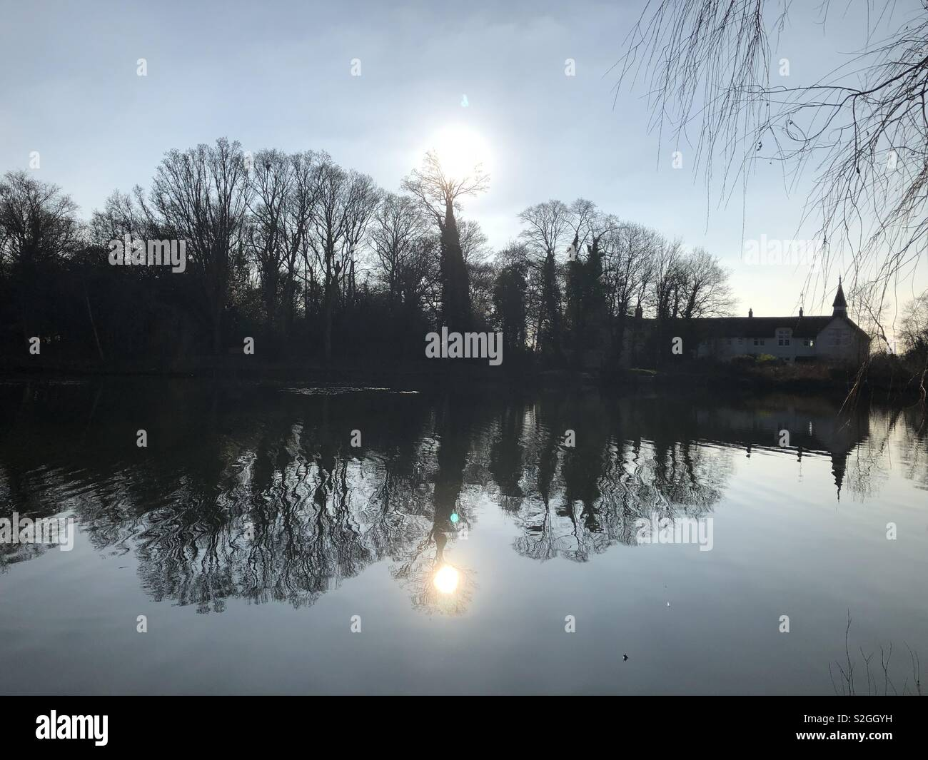 reflections on a fishing lake - Stock Image