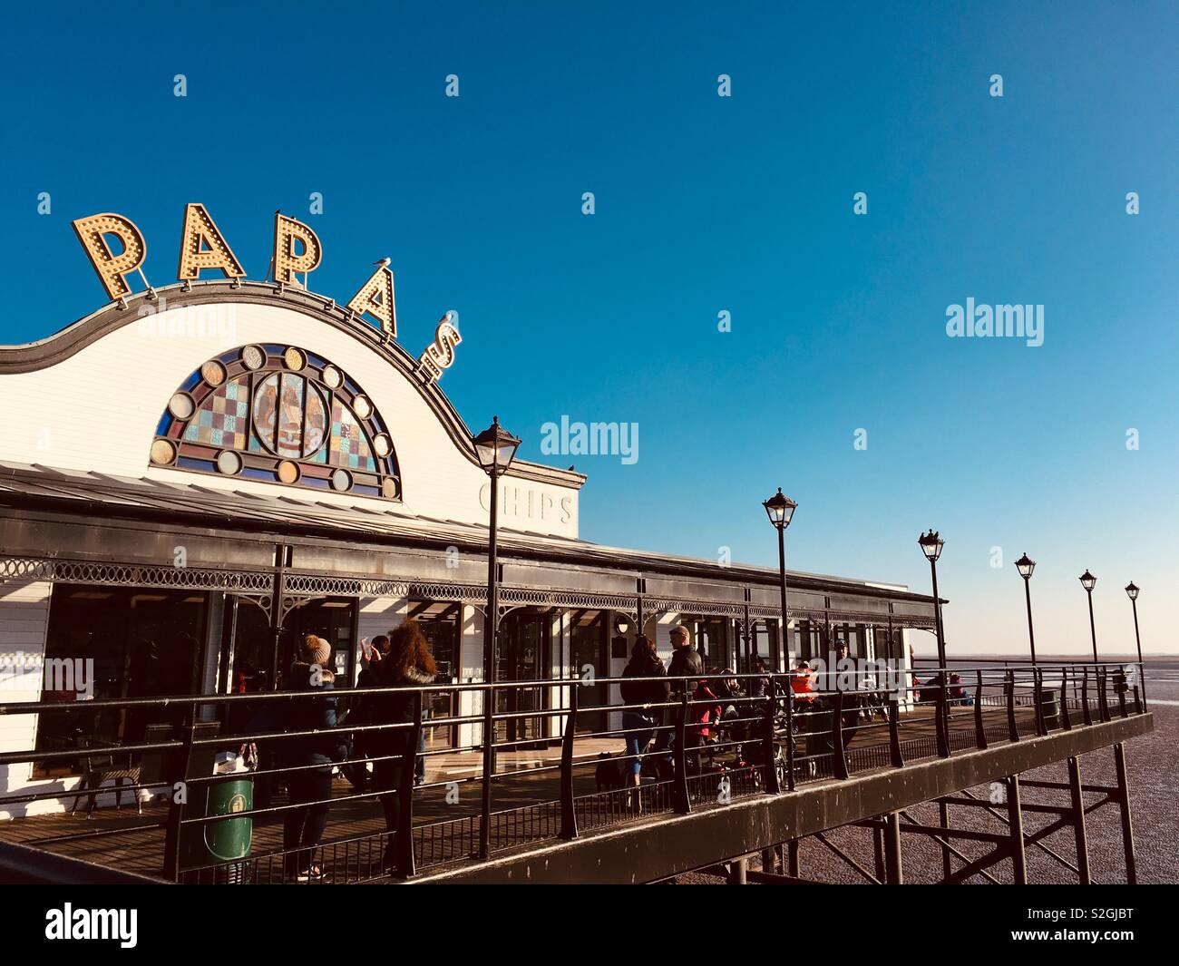 Papas fish and chip restaurant on the pier at Cleethorpes on a sunny winters day. Cleethorpes N.E Lincolnshire England UK - Stock Image
