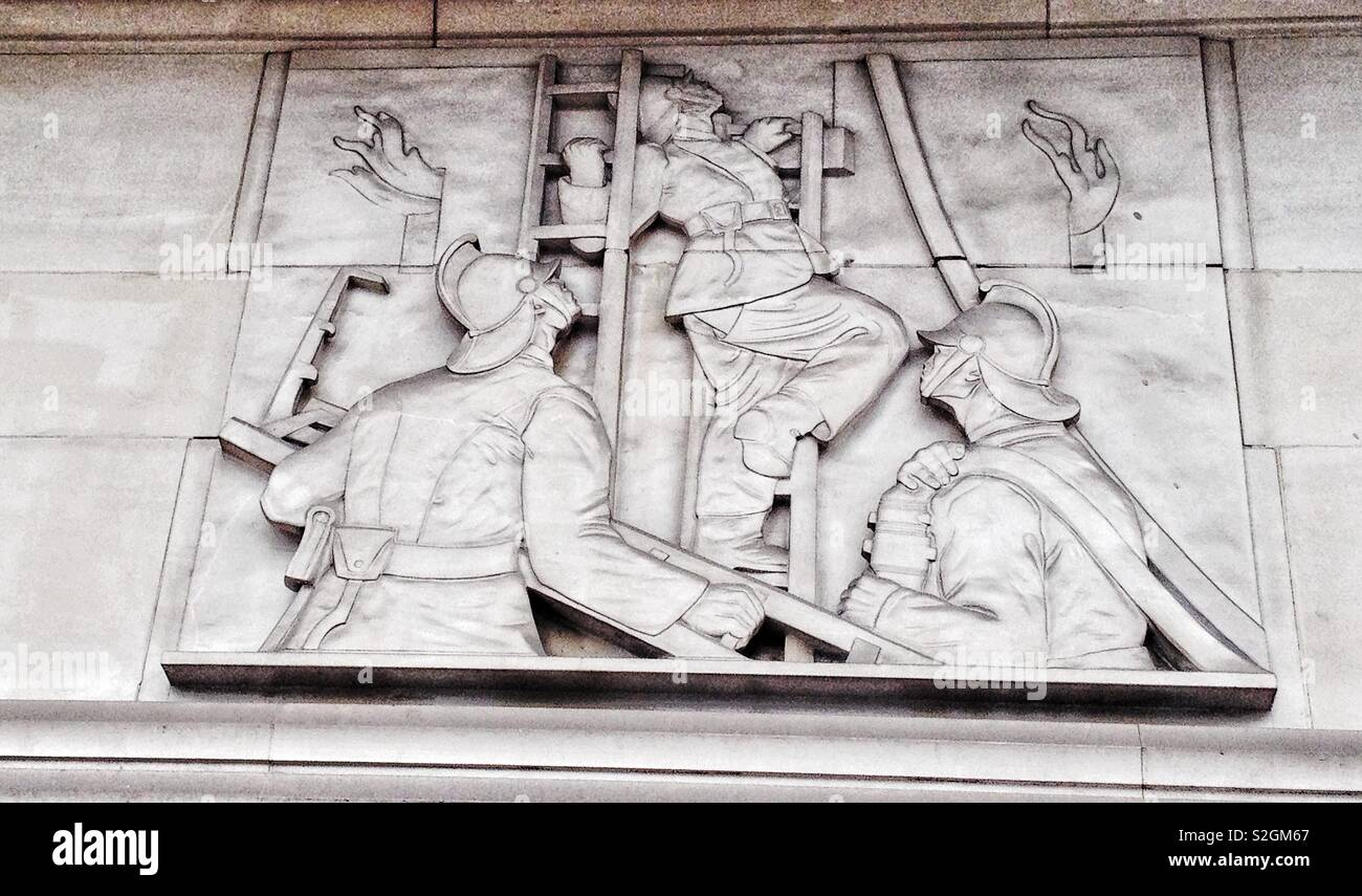 Detail of the 1930's carved relief on the  former London Fire Brigade headquarters building on the Albert Embankment - Stock Image