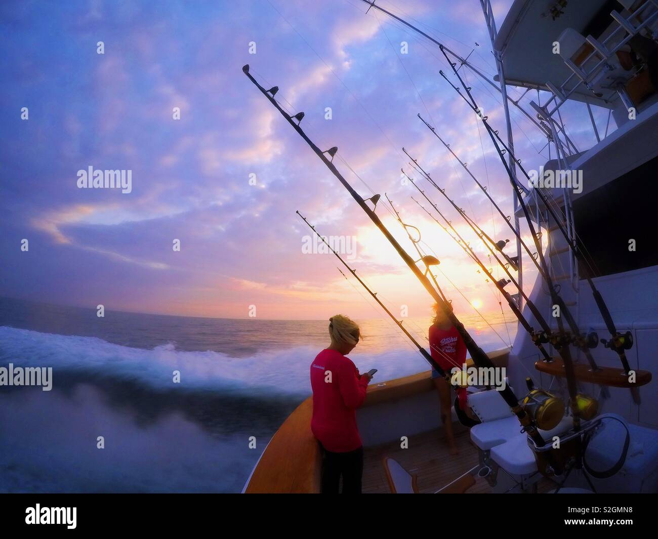 A sportfishing boat heads out to sea off the coast of Ocean City, Maryland. Stock Photo