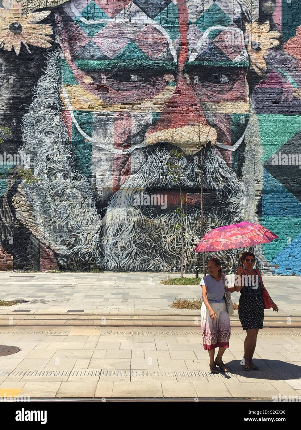 Largest street art mural in the world in Rio. - Stock Image