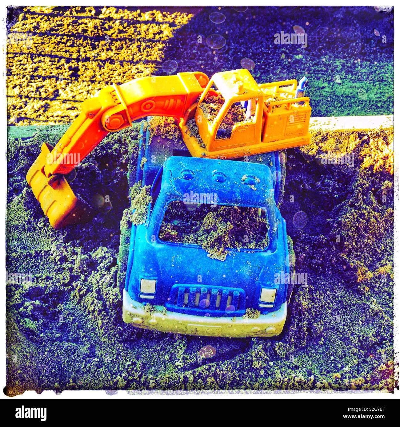 Child struck in a sandbox - Stock Image