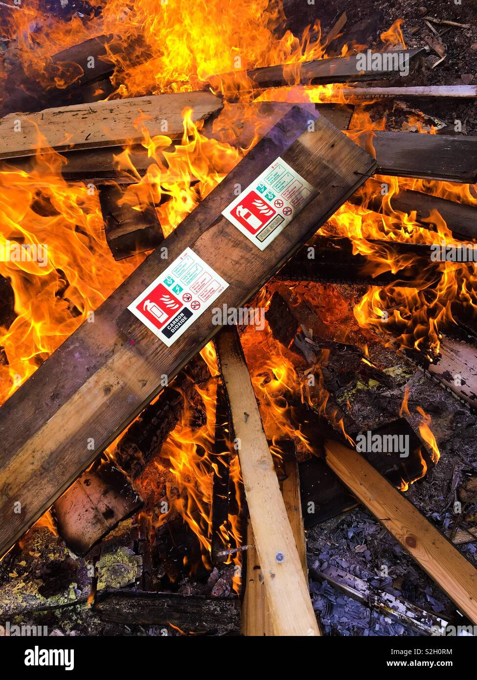 Fire safety signs on fire - Stock Image