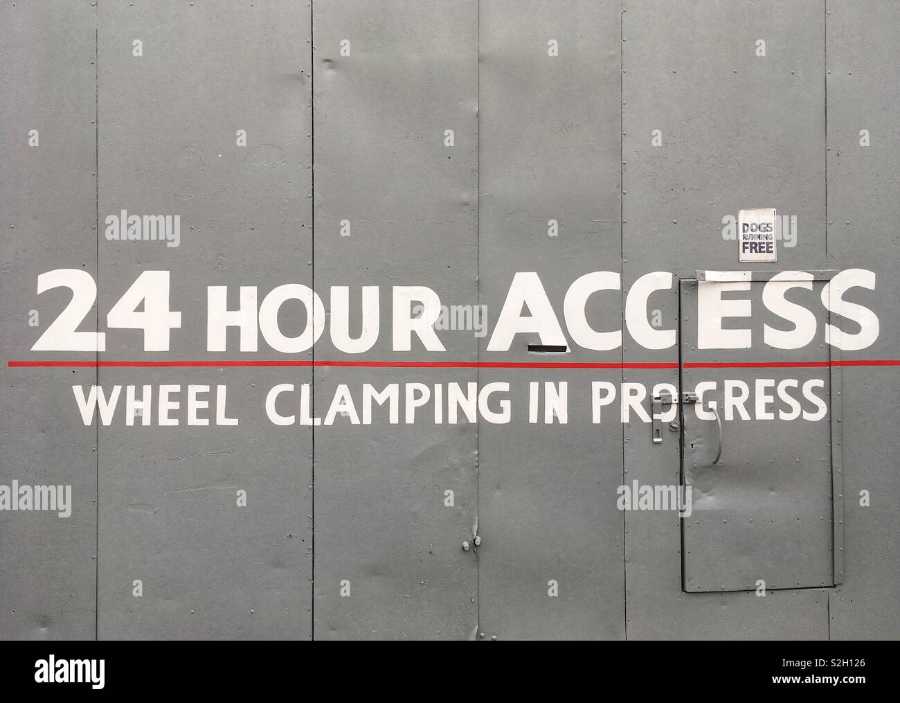 Wheel clamping sign on a doorway in London, England - Stock Image
