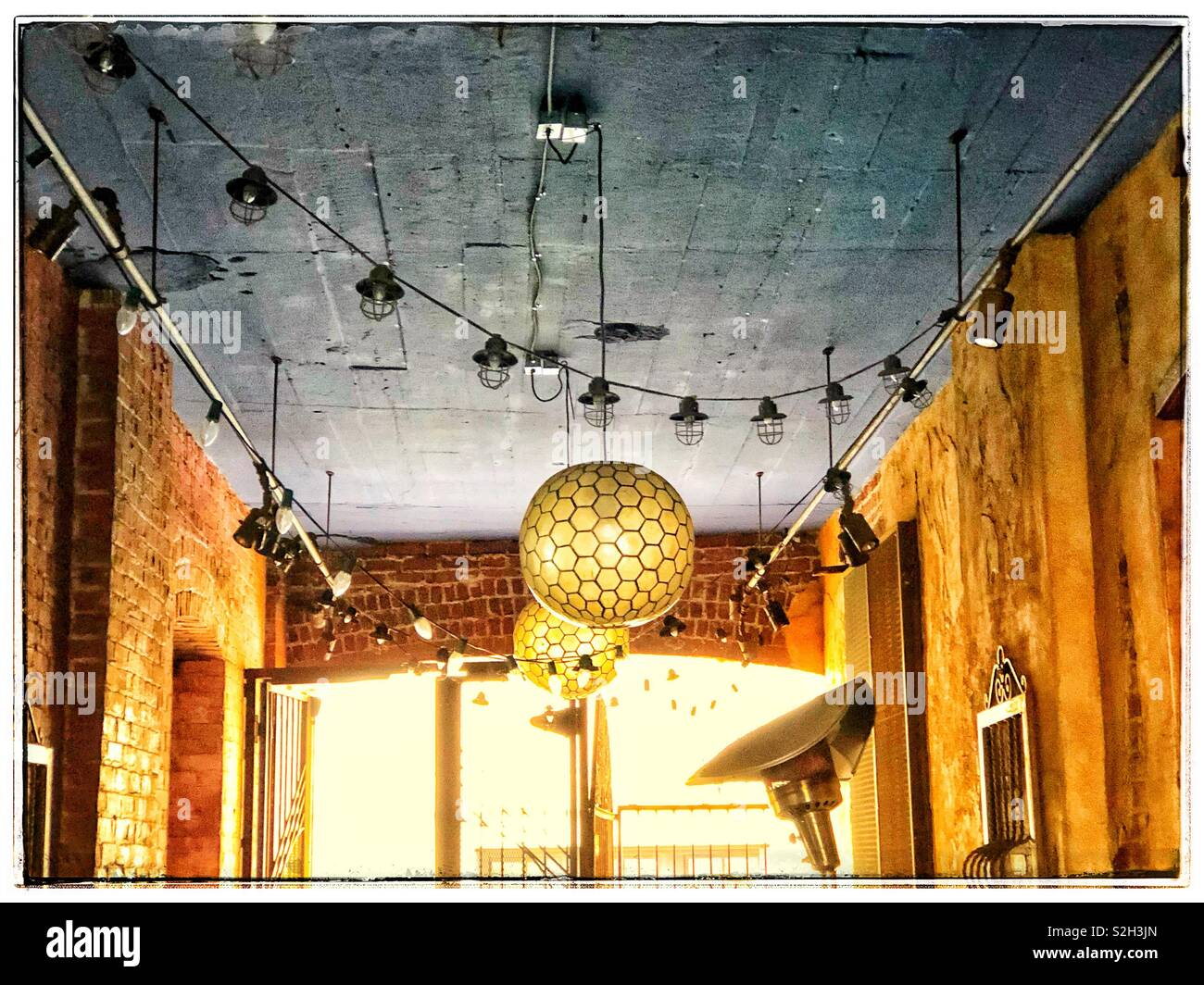Hanging decorative lights in an alleyway Stock Photo