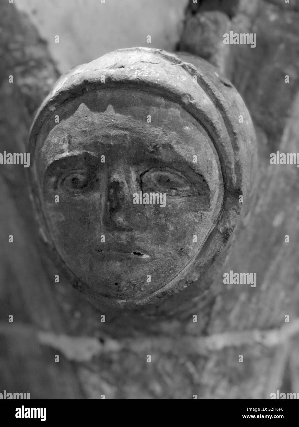A sad and moving 13th or 14th Century sculpture probably representing remorse and sin and the figure has an enlarged eye an apparent disability also seen in portraits of Edward 1. - Stock Image