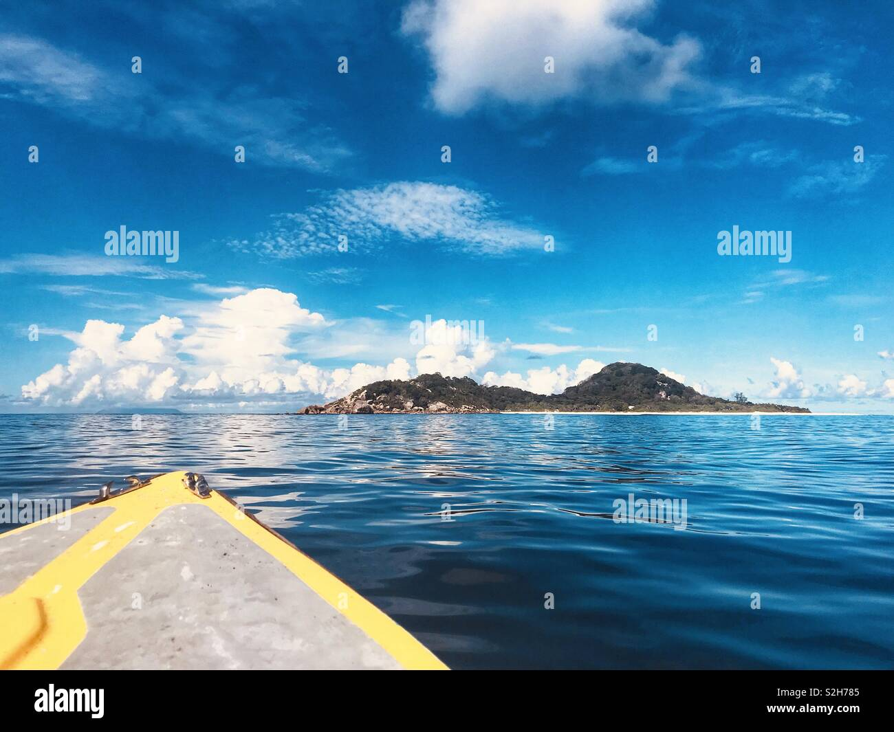 The view of Cousine Island, Seychelles, Indian Ocean from a boat. - Stock Image