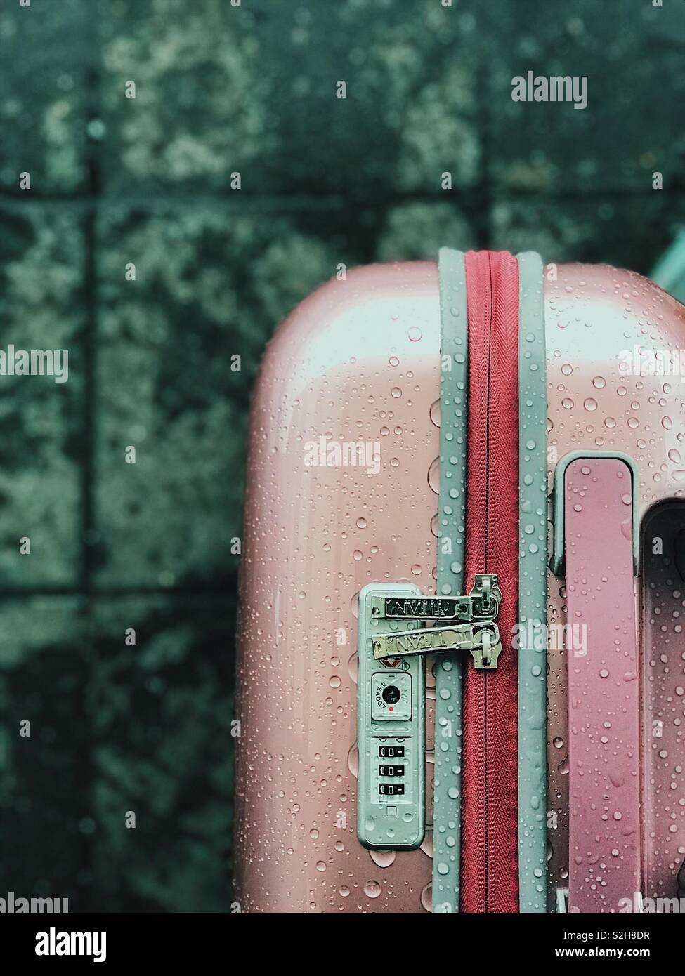 Luggage in the rain - Stock Image