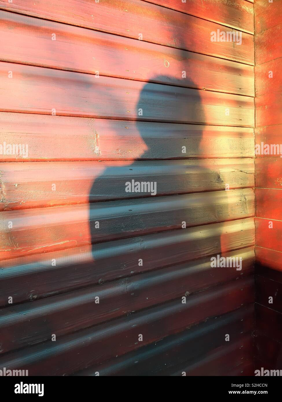 Lady's reflection in the late afternoon sun - Stock Image