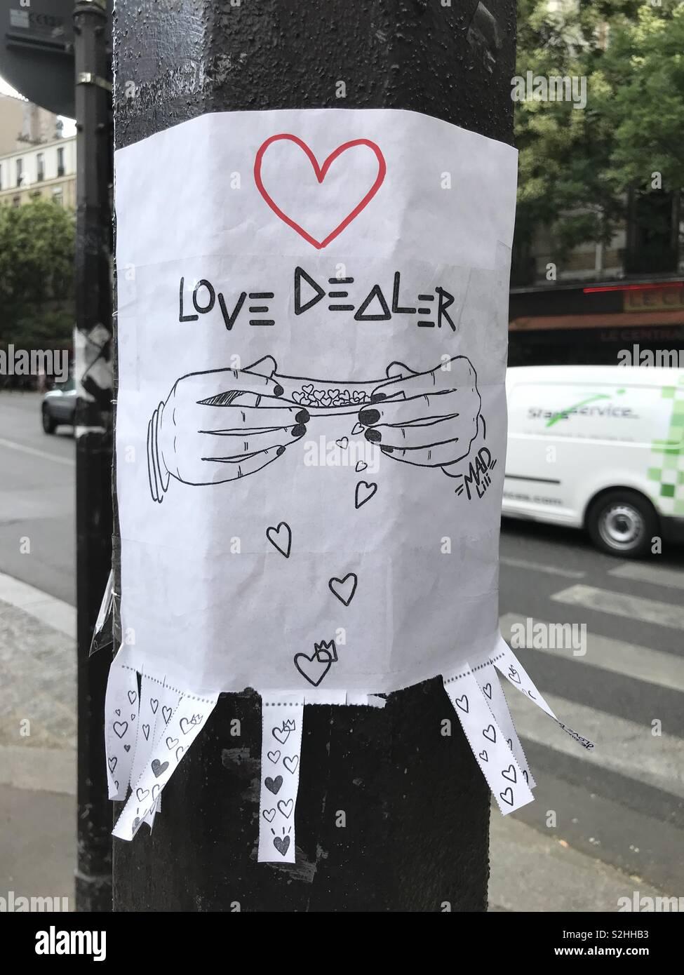A love dealer sign along the street - Stock Image