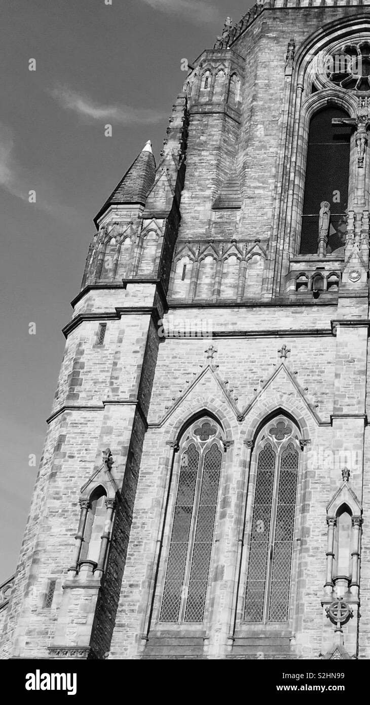 A Black and white photo of The Holy Name Church, on Oxford Road in Manchester, England. - Stock Image