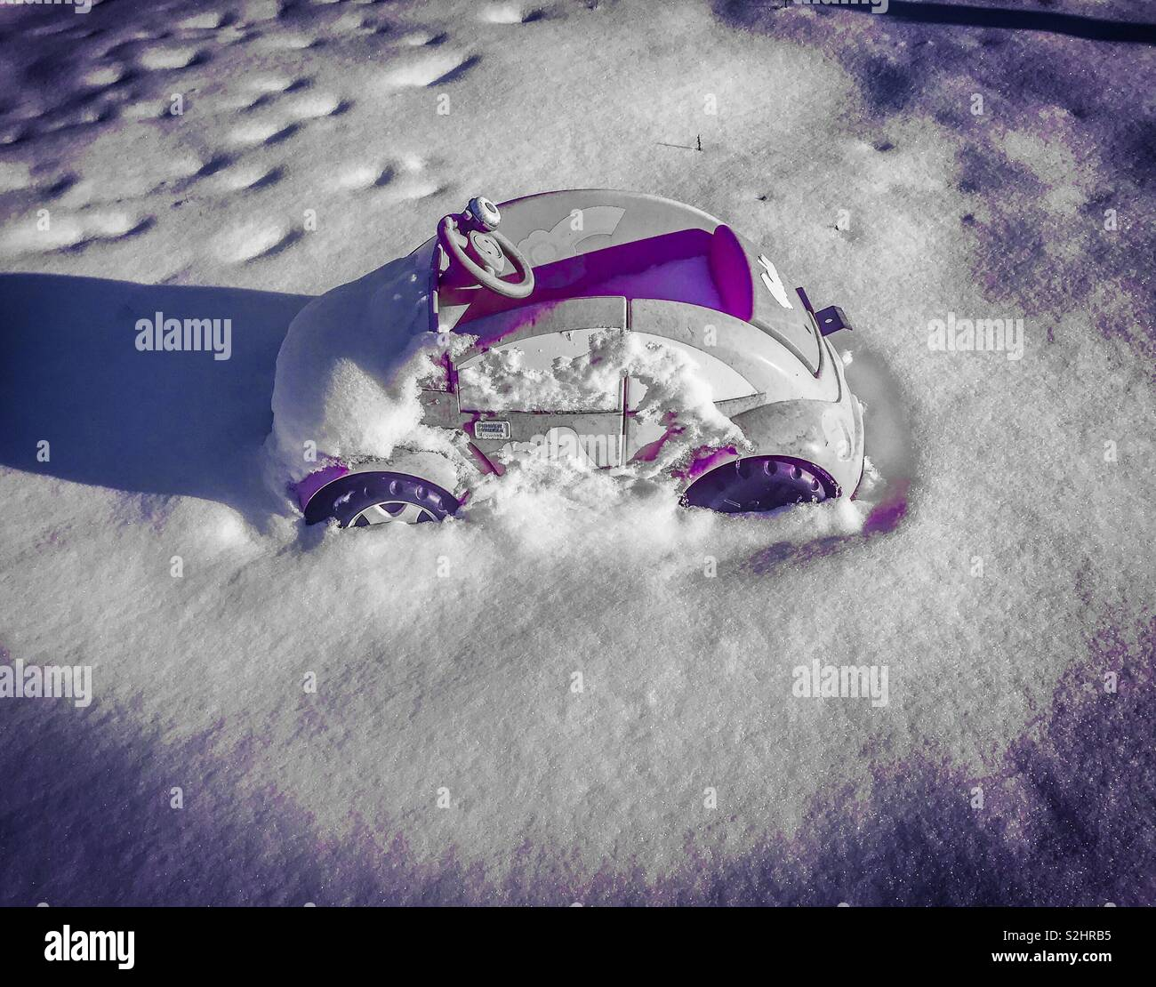 Pink car covered with snow Stock Photo