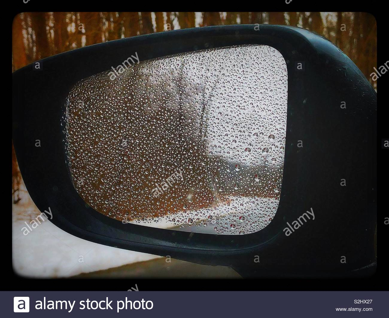 Winter in the rear view mirror - Stock Image