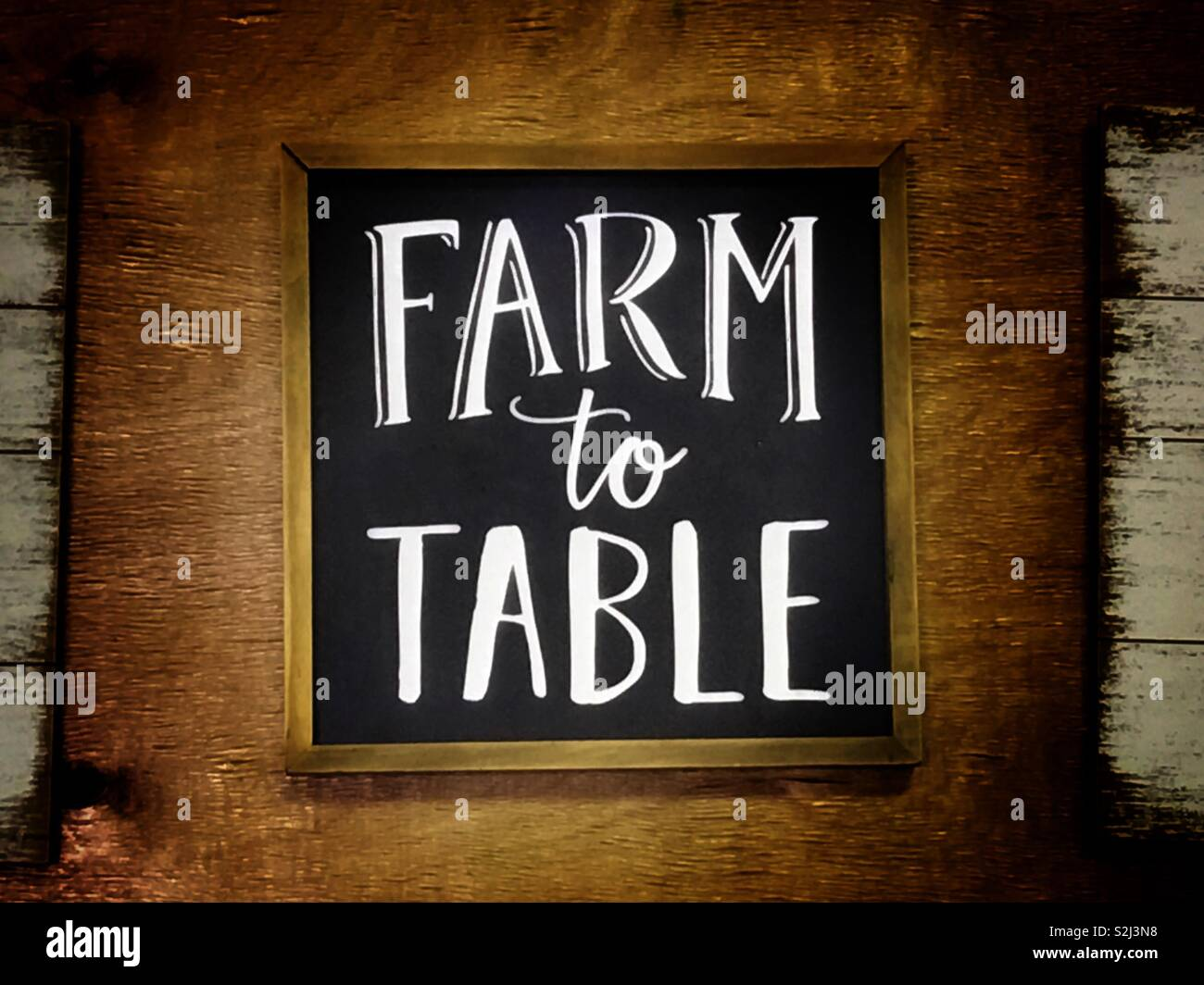 Farm to table movement encouraging everyone to buy locally grown food - Stock Image
