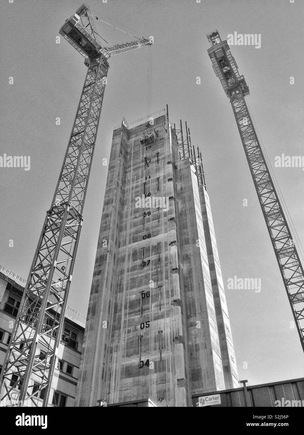 Concrete new build core and cranes on a building site in the City of London, England, UK. - Stock Image