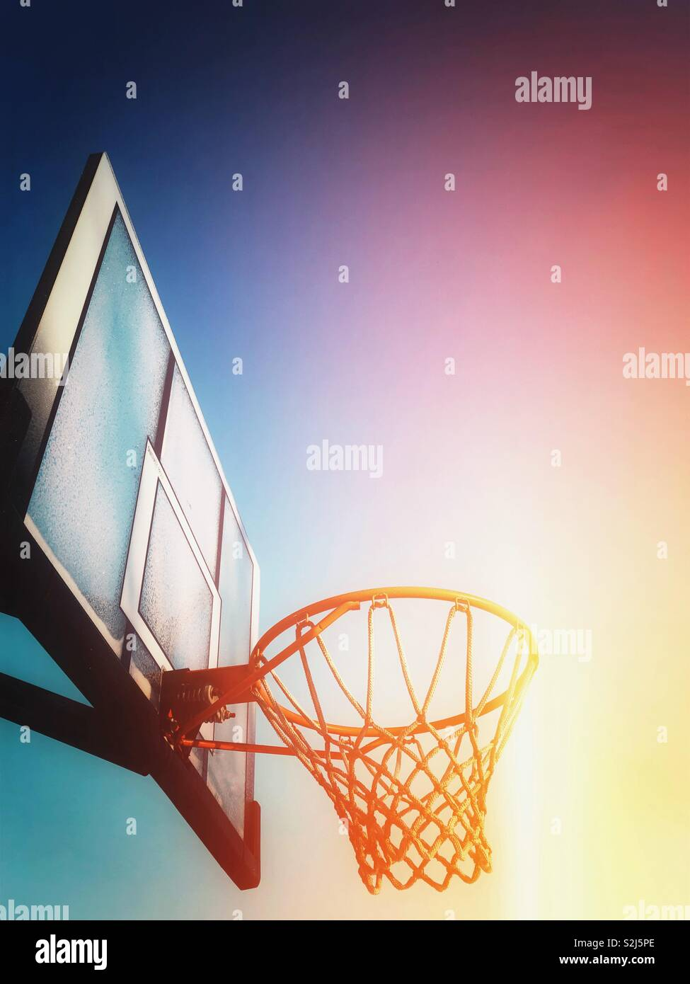Looking up at basketball net - Stock Image