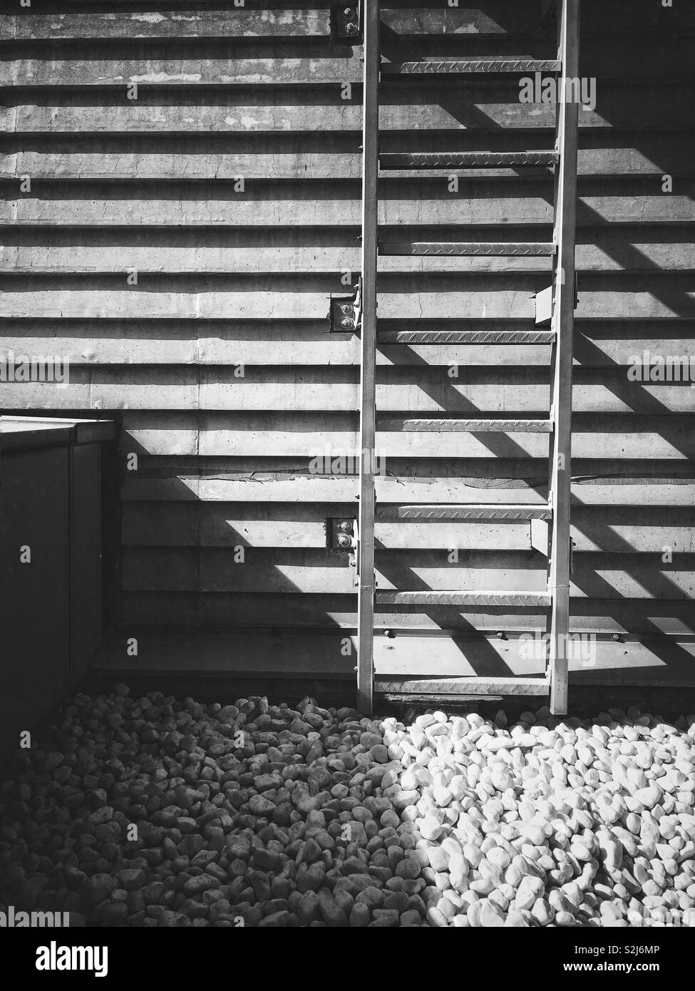 Ladder on a side of a wall. Minimalistic photo. - Stock Image