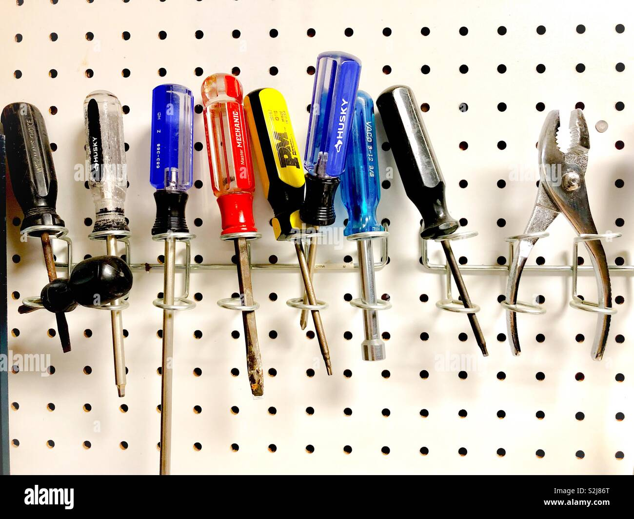 Tools on a peg board - Stock Image