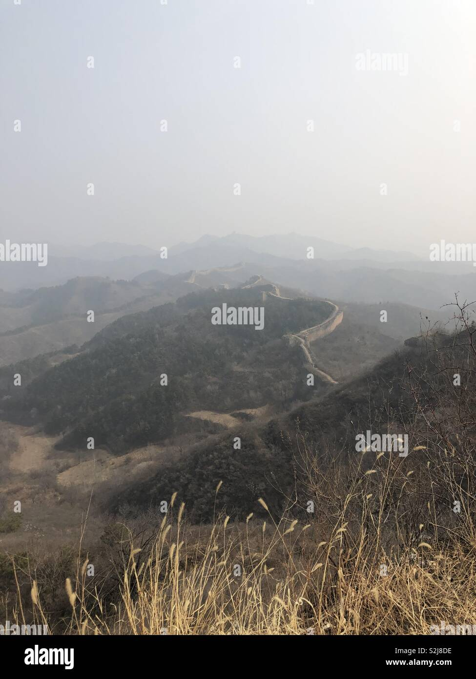 Wistful view over the Great Wall of China - Stock Image