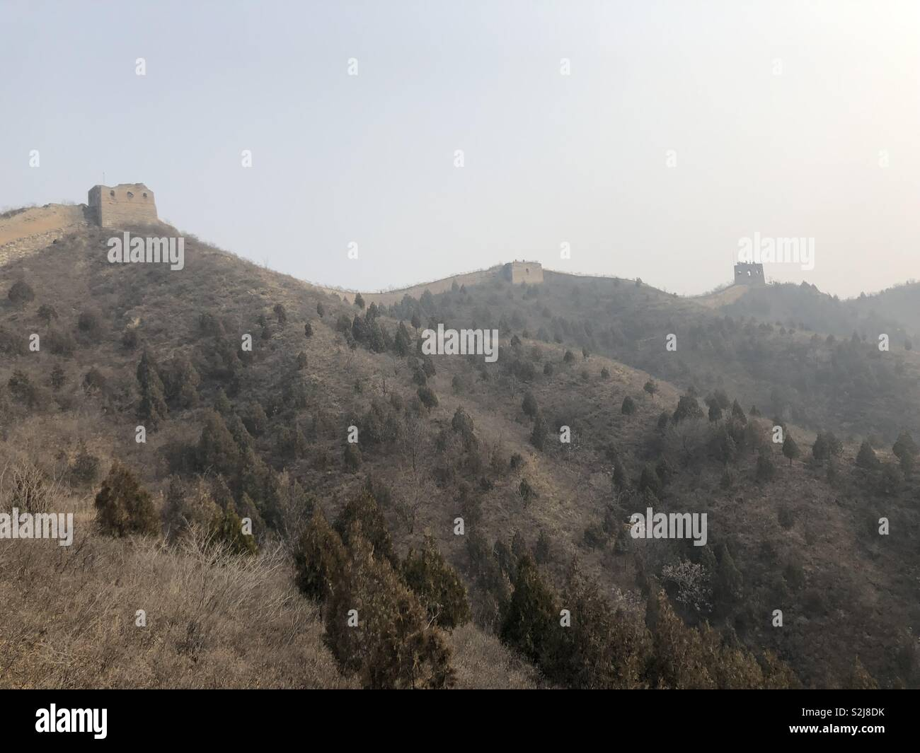 The Great Wall of China on the skyline in wistful weather - Stock Image