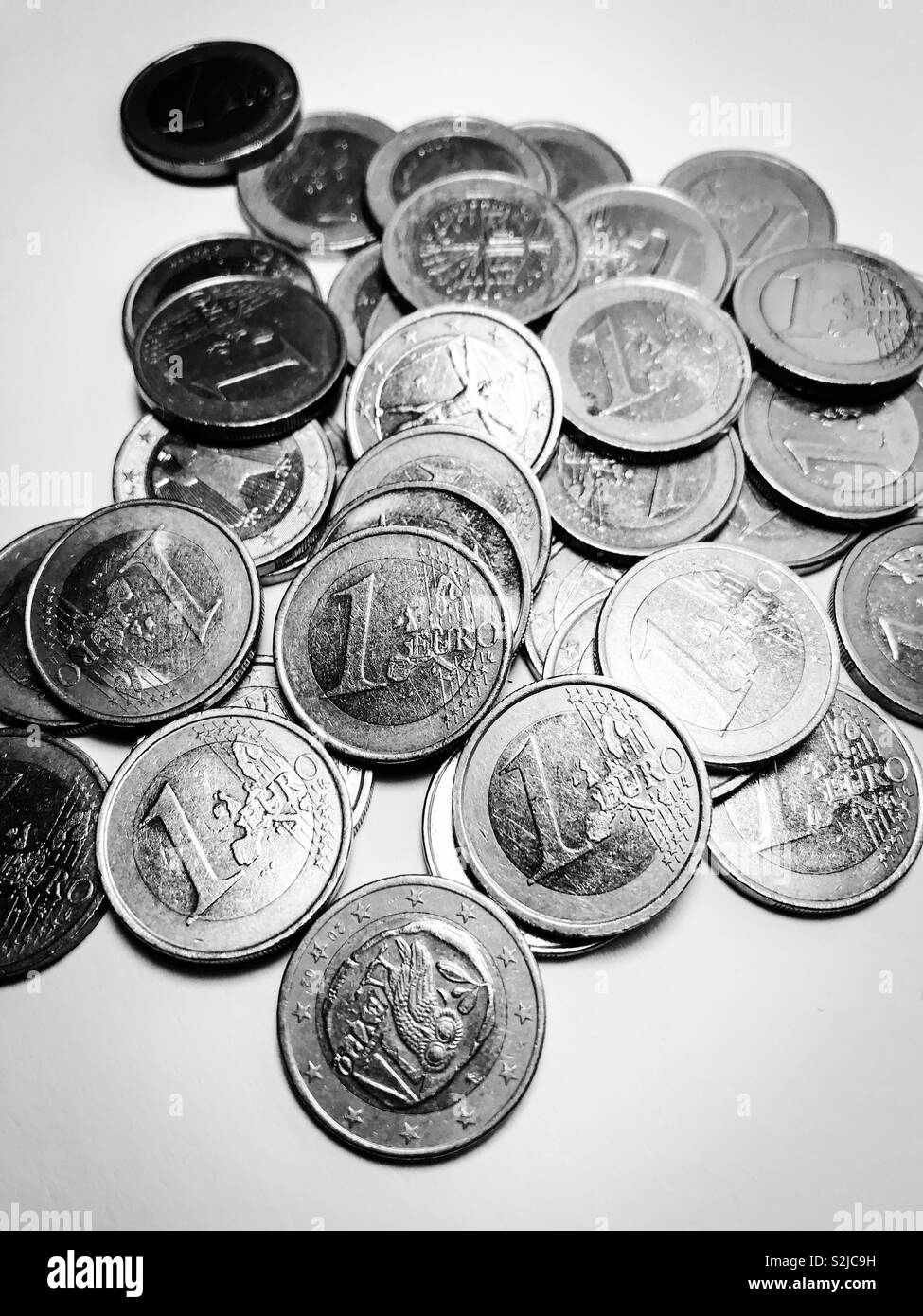 Pile of one euro coins - black and white - Stock Image