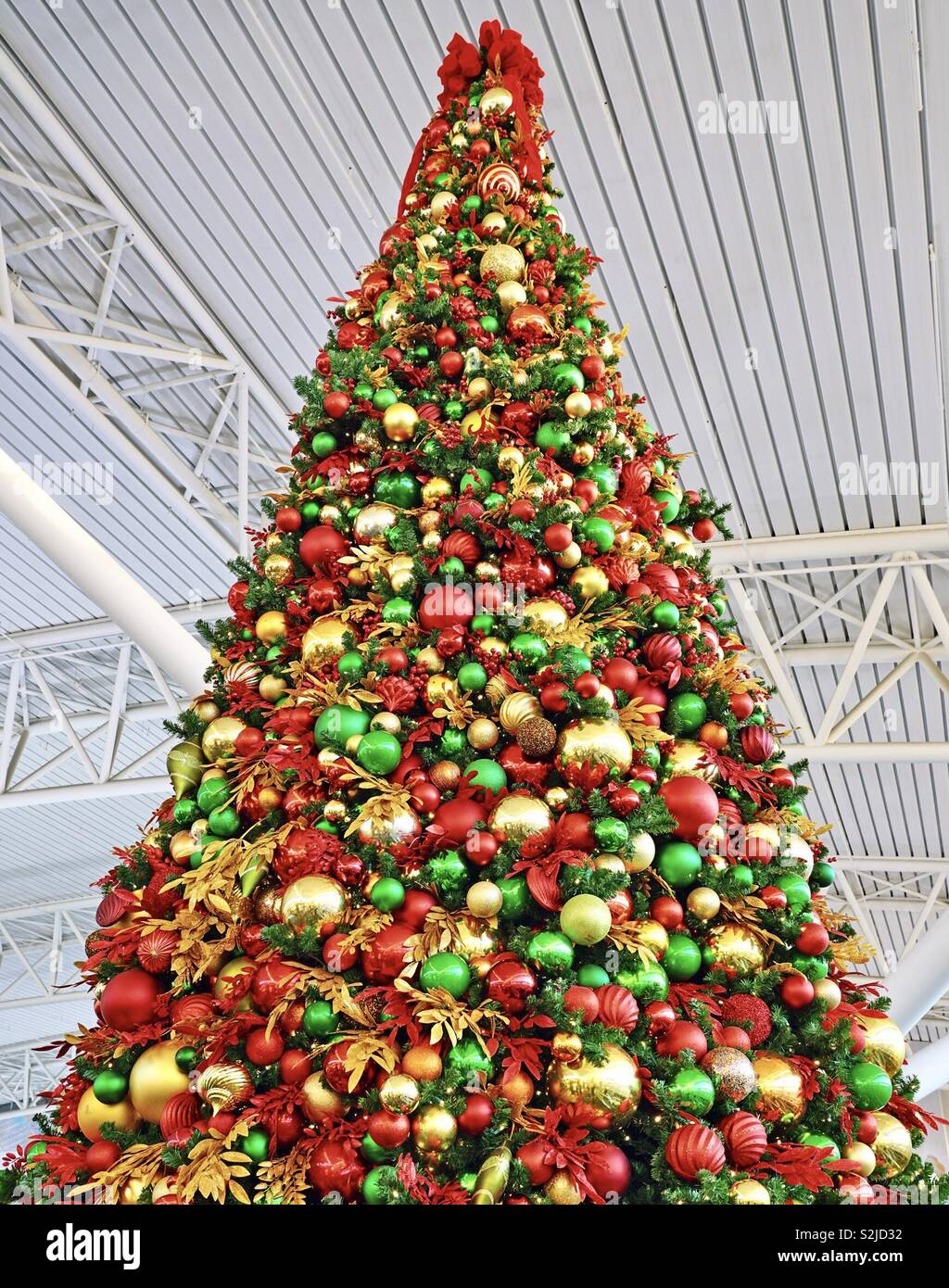 A Giant Christmas Tree Decorated With Red Green And Gold Holiday Ornaments Stock Photo Alamy