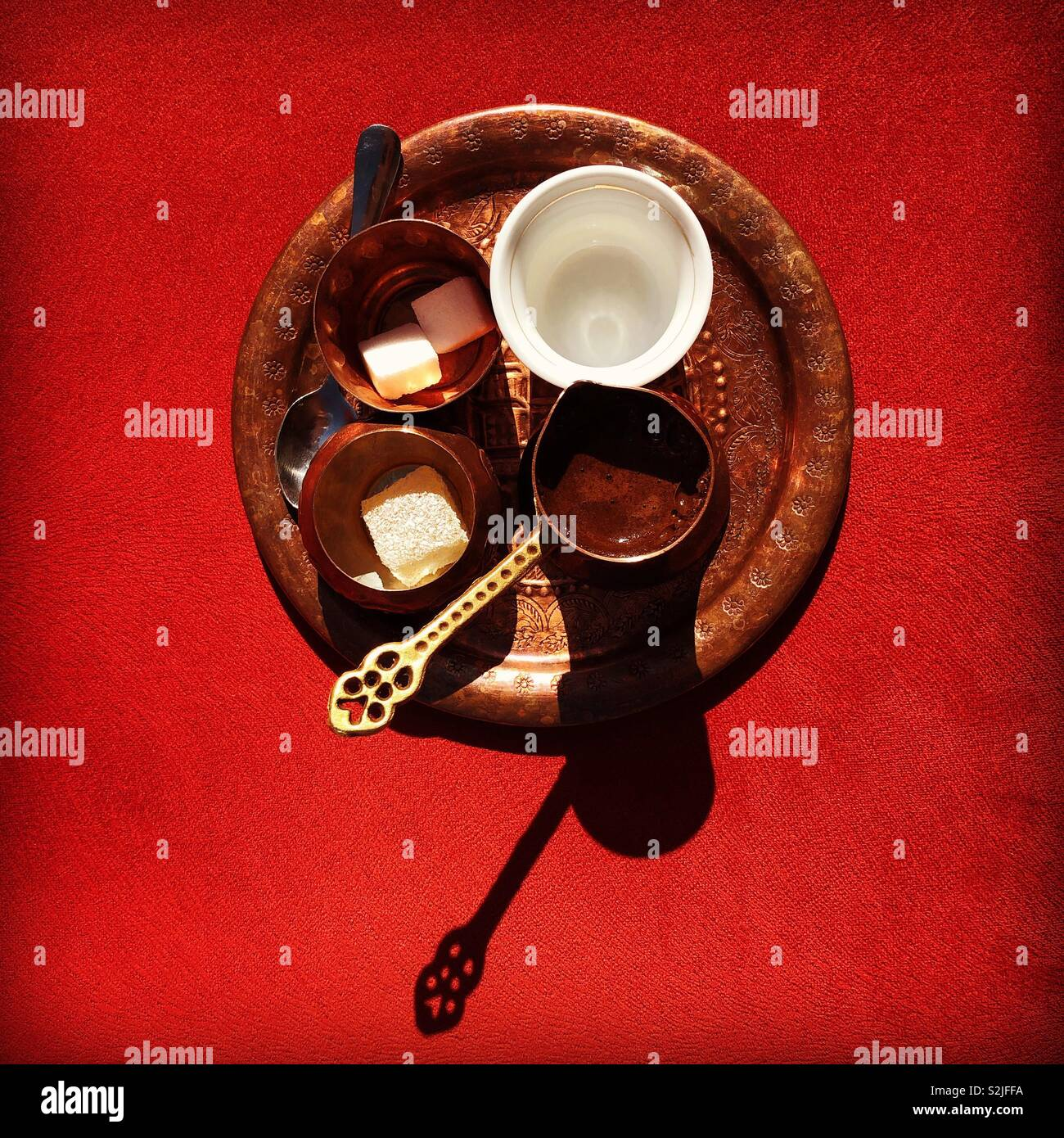 Bosnian coffee set on the red background in Sarajevo, Bosnia and Herzegovina. - Stock Image