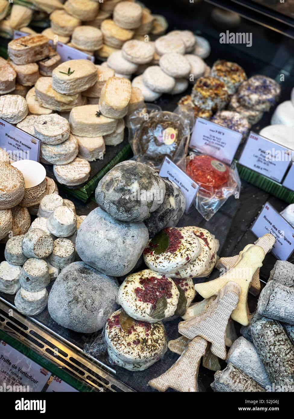 A wide variety of cheese and fromage on sale from a Parisian shop - Stock Image