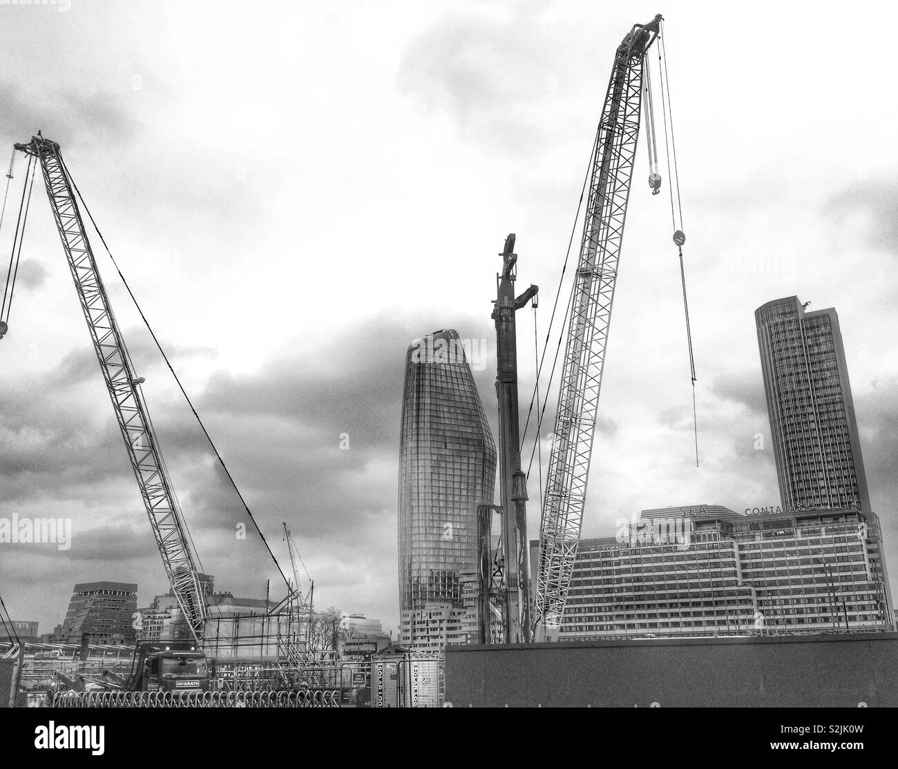 Construction site working on the new River Thames super sewer looking over towards the south bank of the river, London, England, UK. - Stock Image