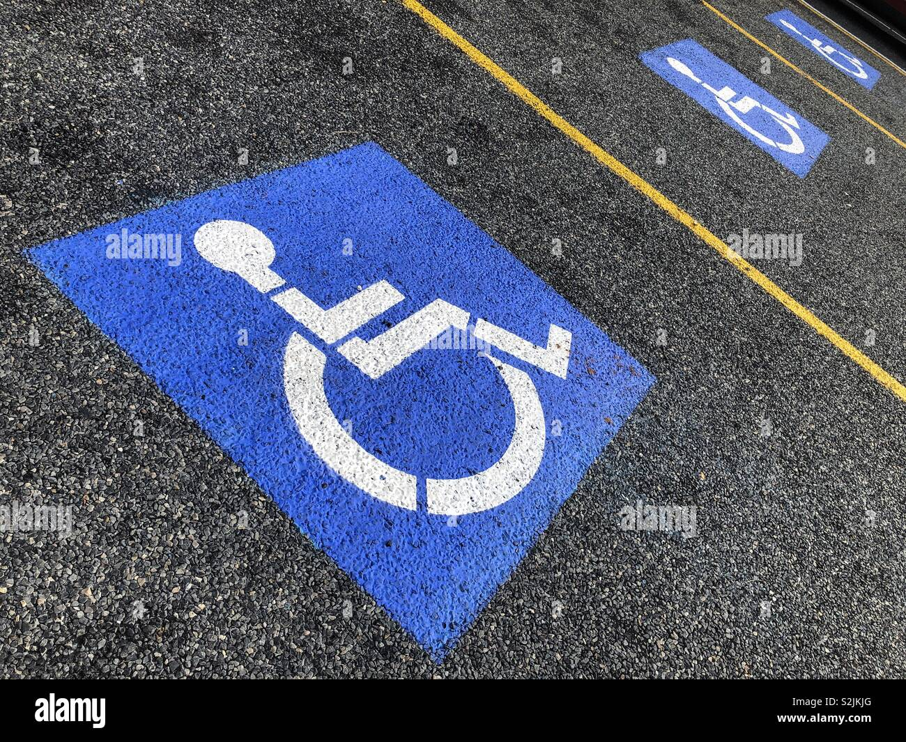 Parking spots reserved for people with disabilities. Stock Photo