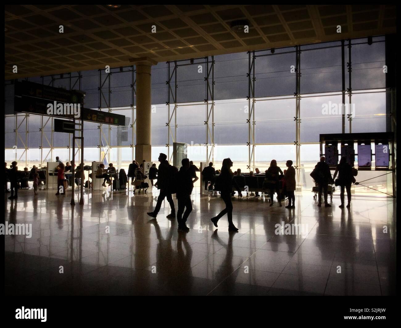Travellers in 'Departures' at Barcelona El Prat airport, Catanonia, Spain. - Stock Image