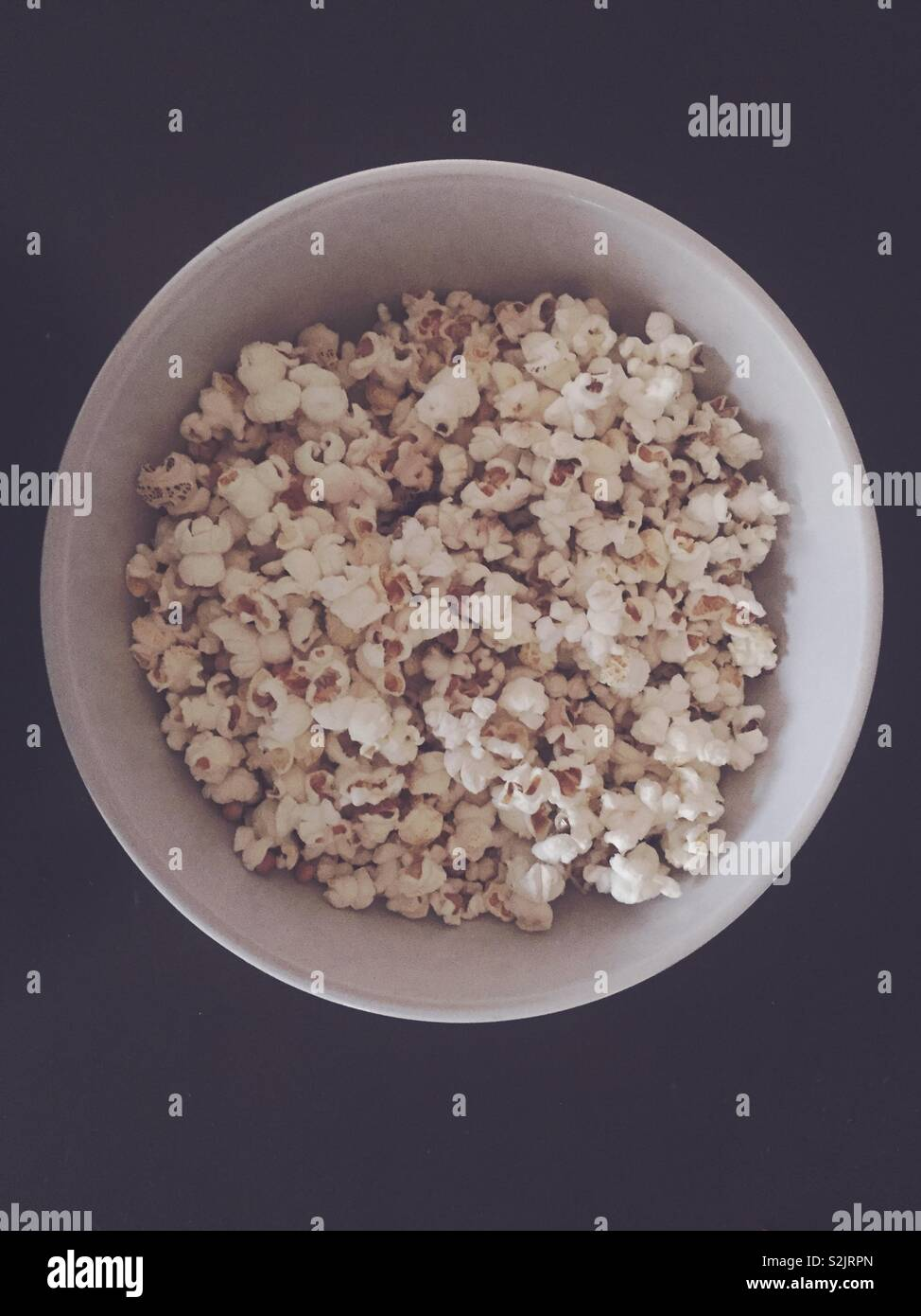 Home made popcorn inside of bowl. No microwave. - Stock Image