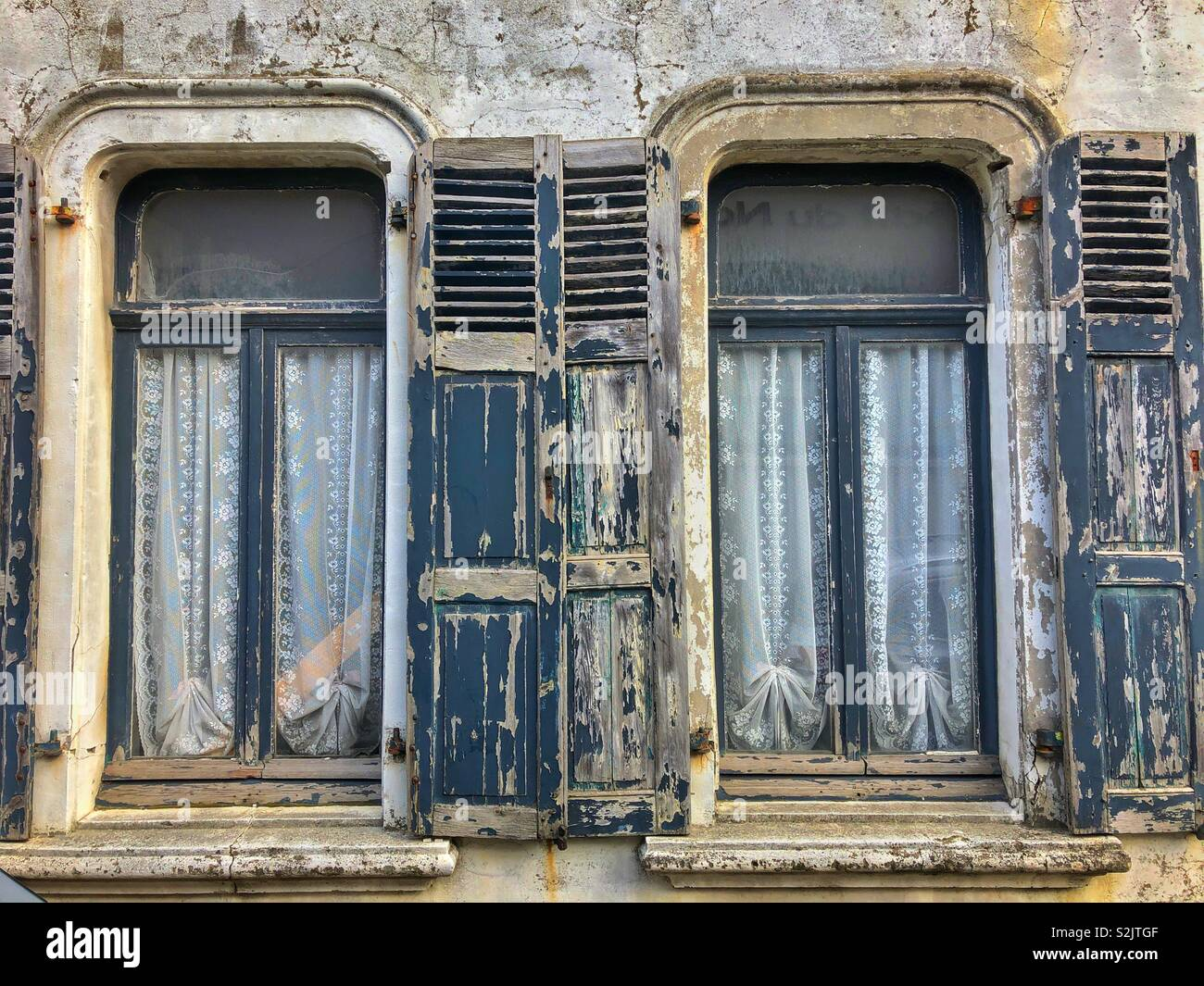 Old shuttered windows in a french town - Stock Image