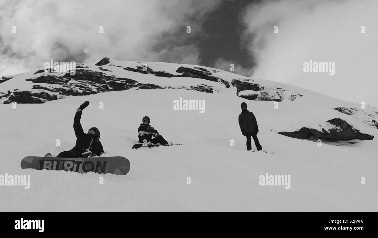Snowboarders admiring the view - Stock Image