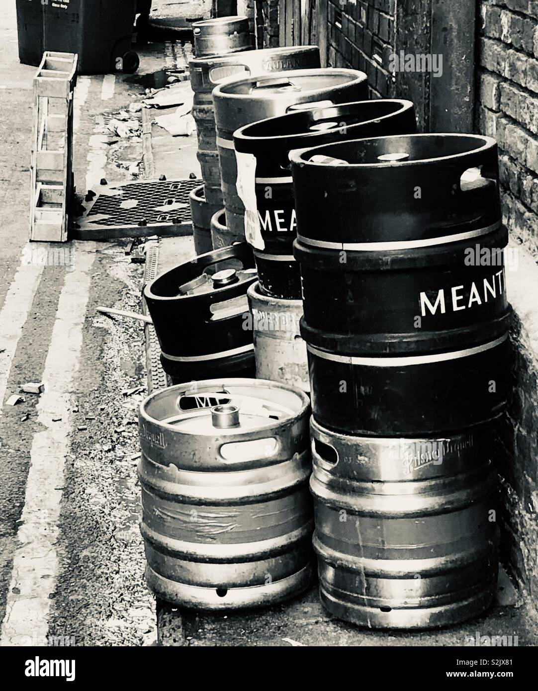 Empty beer casks on the street after the weekend - Stock Image