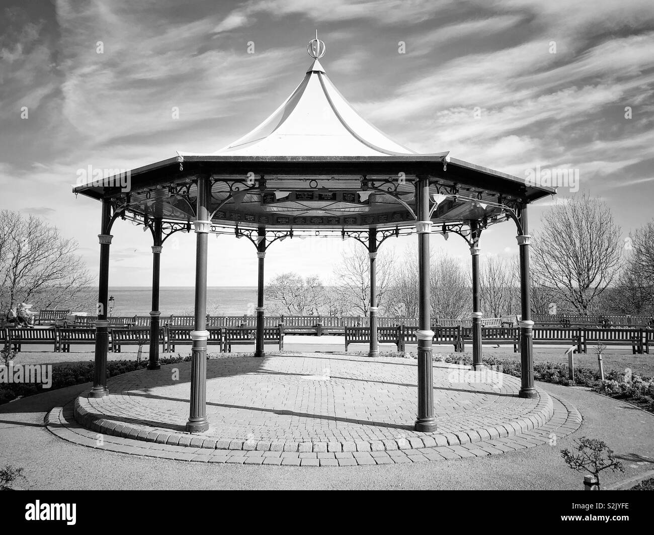 The bandstand in Crescent Gardens, Filey, UK. Black and white image - Stock Image