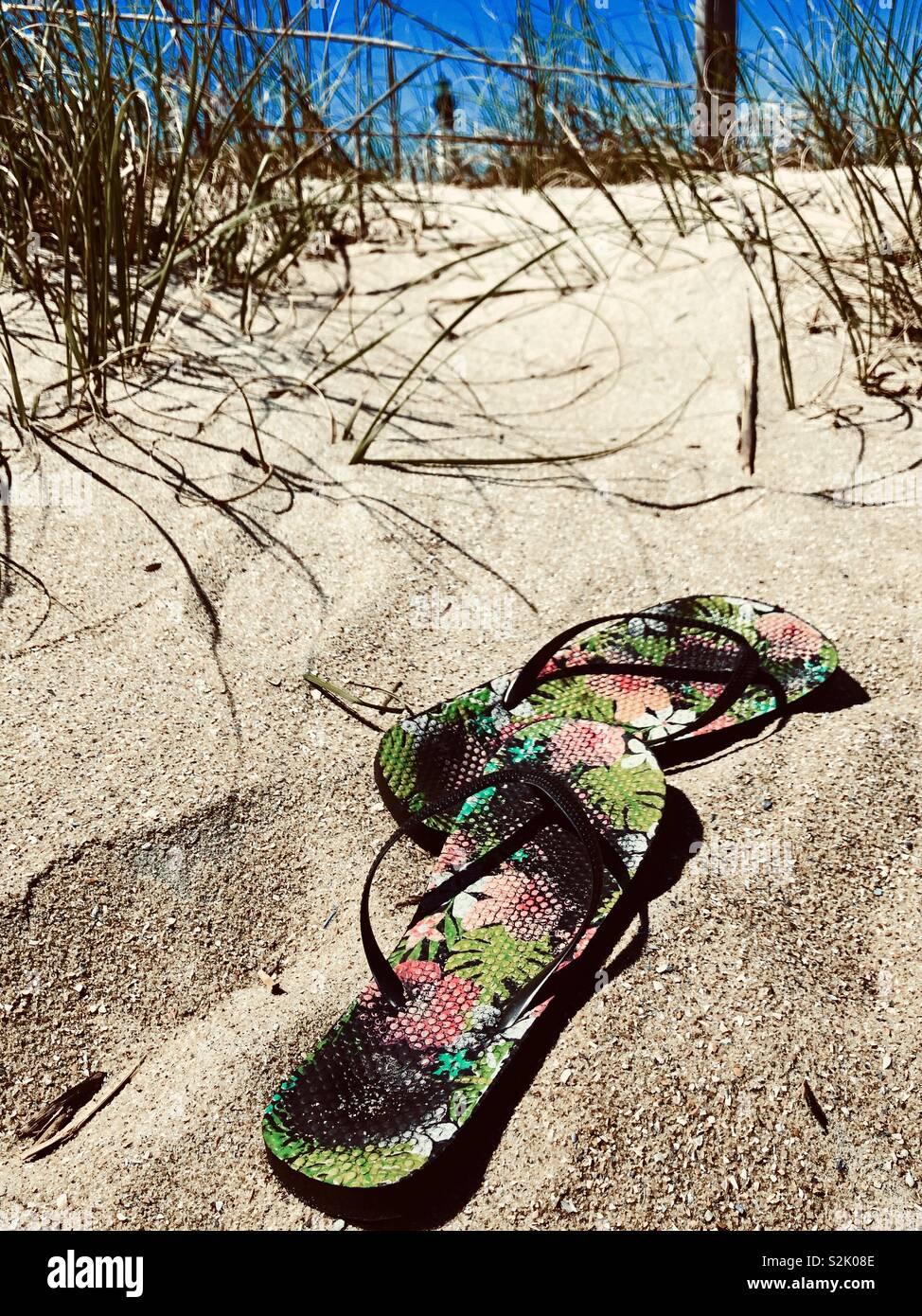 Flip flops on beach - Stock Image