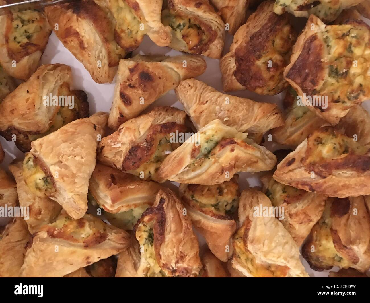 Plate of savory pastries, views closeup from above - Stock Image