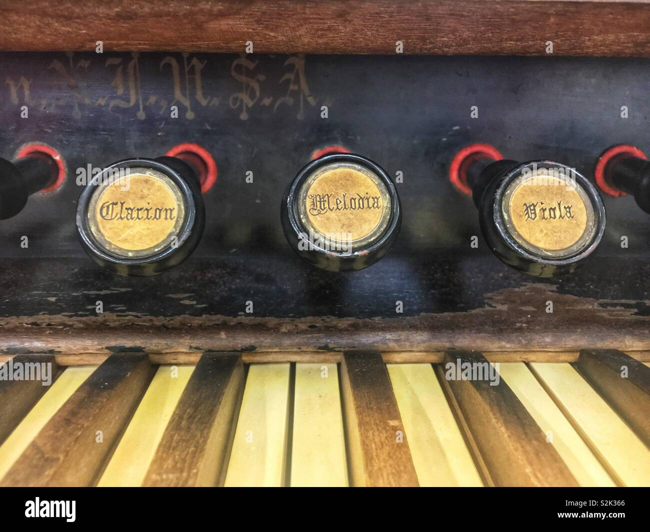 Clarion, melodic, viola keys prominently displayed on an antique wooden organ. - Stock Image