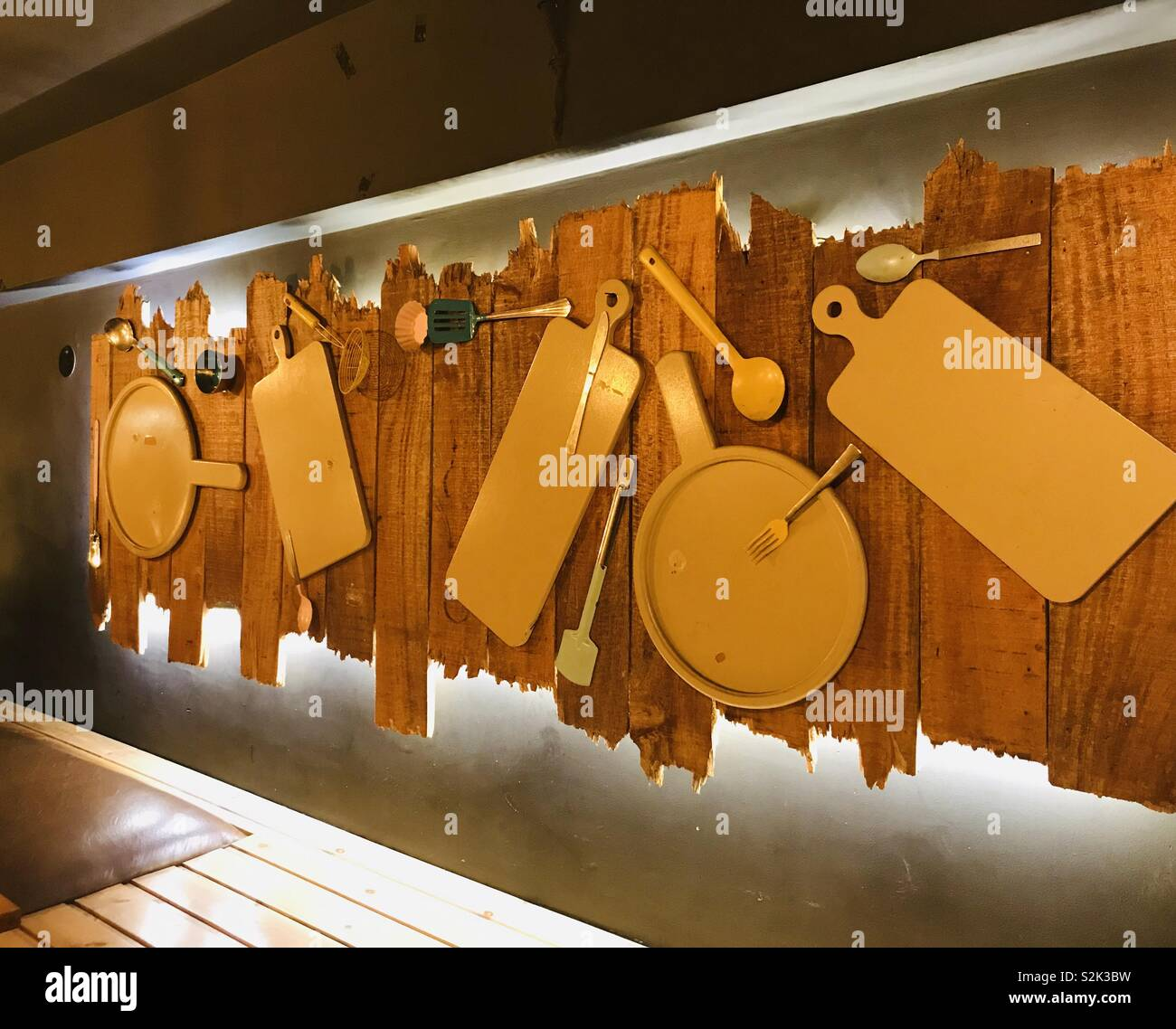Wall piece decor with kitchen gadgets. - Stock Image