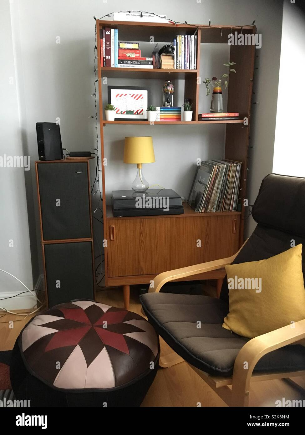 Corner Of A Stylish Living Room With A Record Player Books And Other Decorative Items On A Retro Wooden Unit Stock Photo Alamy