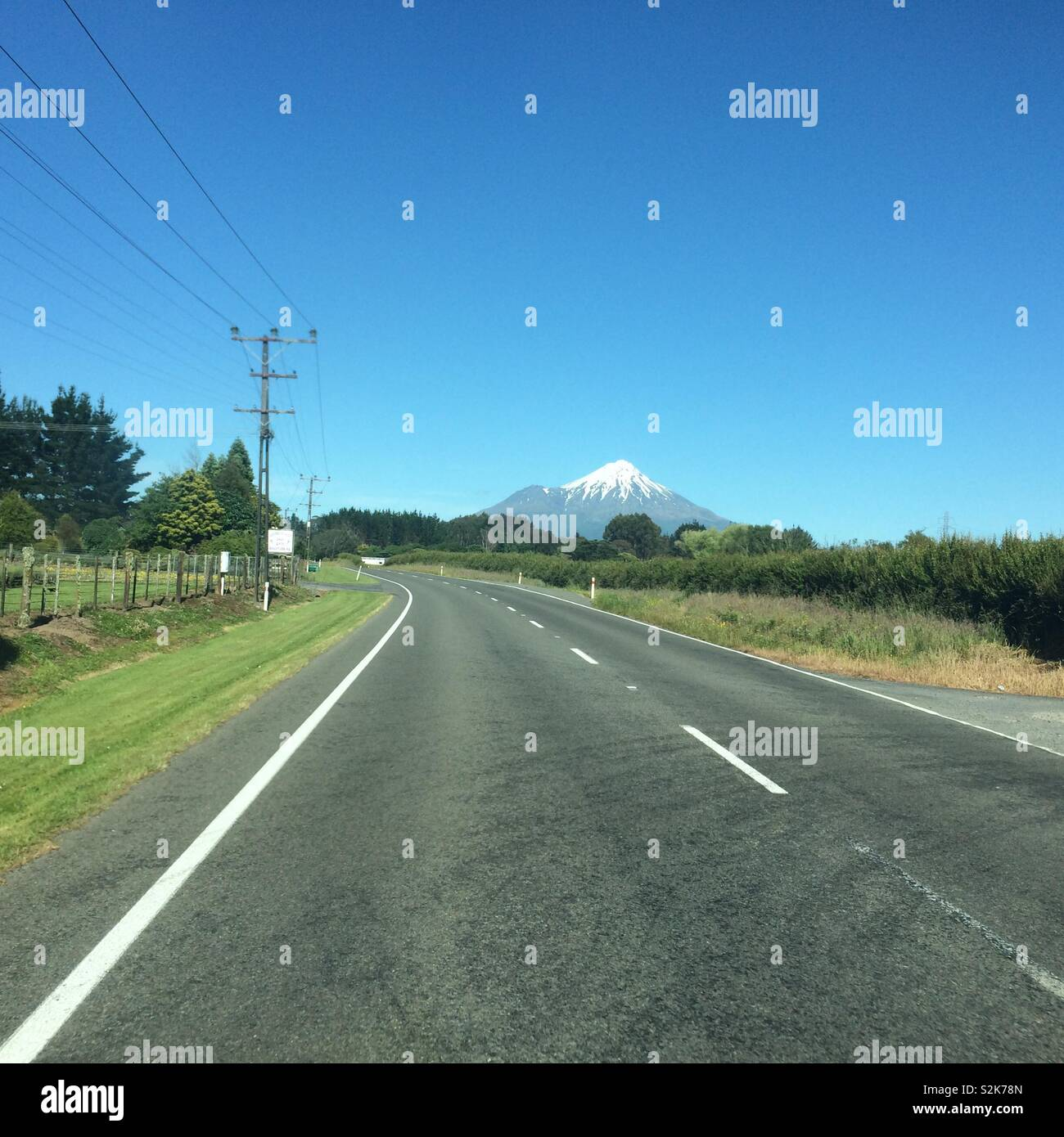 View of Mount Taranaki / Mount Egmont driving along state highway 43, New Zealand - Stock Image