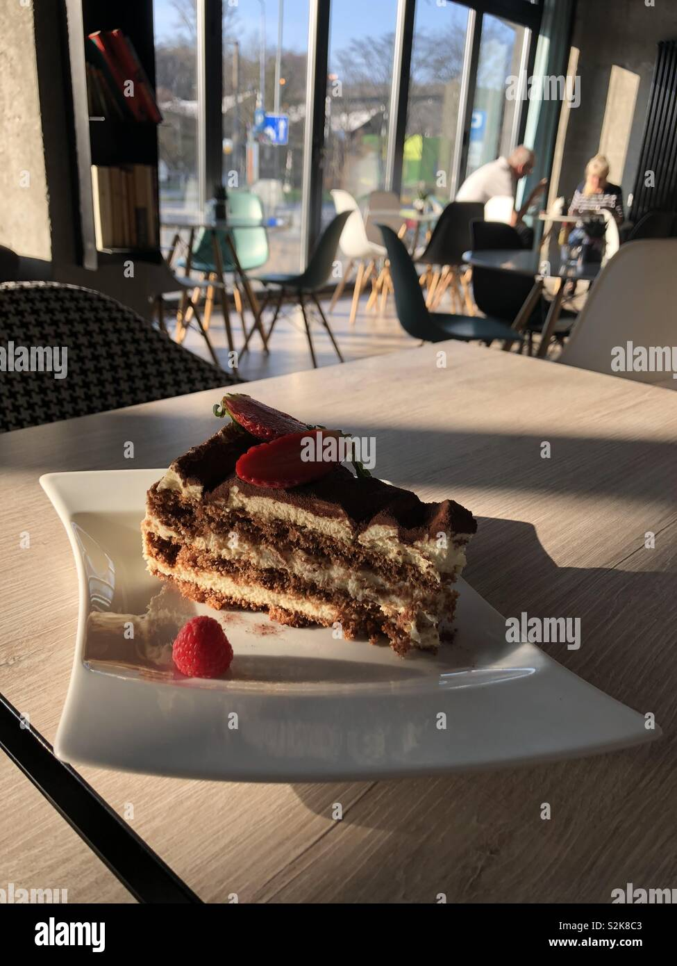 Freetime at cafe with a piece of tiramisu. - Stock Image