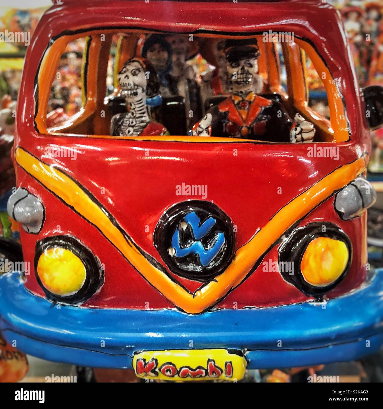 Fun ceramic VW bus with Skeletons as passengers in gift shop in Mexico - Stock Image