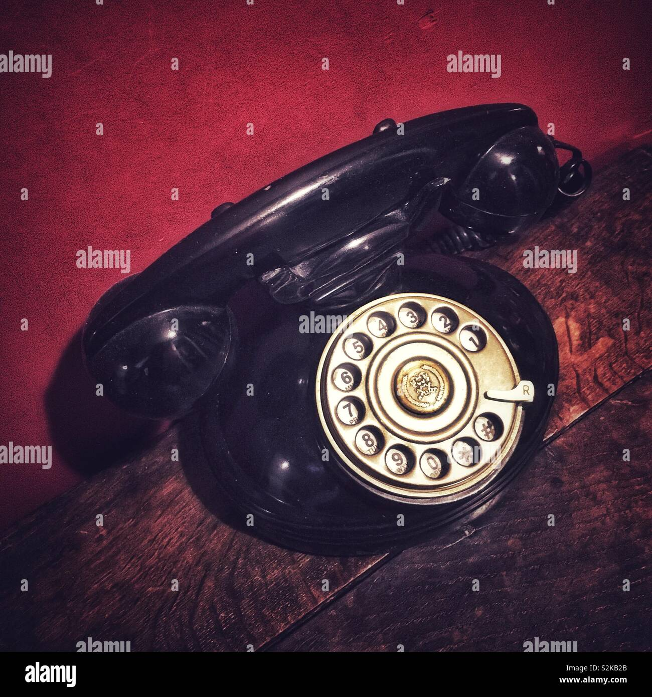 Old telephone with handset and dial - Stock Image
